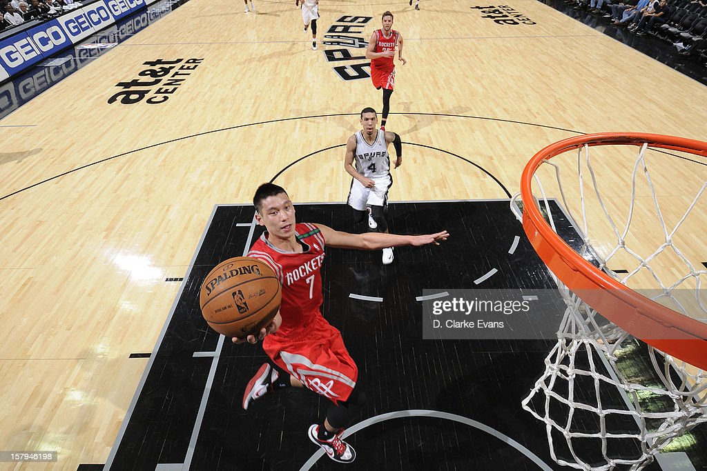 <a gi-track='captionPersonalityLinkClicked' href=/galleries/search?phrase=Jeremy+Lin&family=editorial&specificpeople=6669516 ng-click='$event.stopPropagation()'>Jeremy Lin</a> #7 of the Houston Rockets drives to the basket against the San Antonio Spurs on December 7, 2012 at the AT&T Center in San Antonio, Texas.