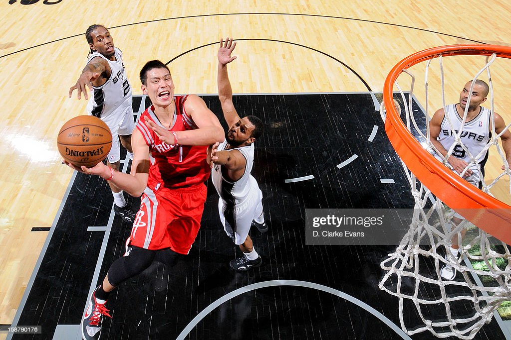 Jeremy Lin #7 of the Houston Rockets drives to the basket against the San Antonio Spurs on December 28, 2012 at the AT&T Center in San Antonio, Texas.