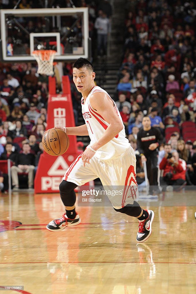 <a gi-track='captionPersonalityLinkClicked' href=/galleries/search?phrase=Jeremy+Lin&family=editorial&specificpeople=6669516 ng-click='$event.stopPropagation()'>Jeremy Lin</a> #7 of the Houston Rockets drives to the basket against the New Orleans Hornets on January 2, 2013 at the Toyota Center in Houston, Texas.