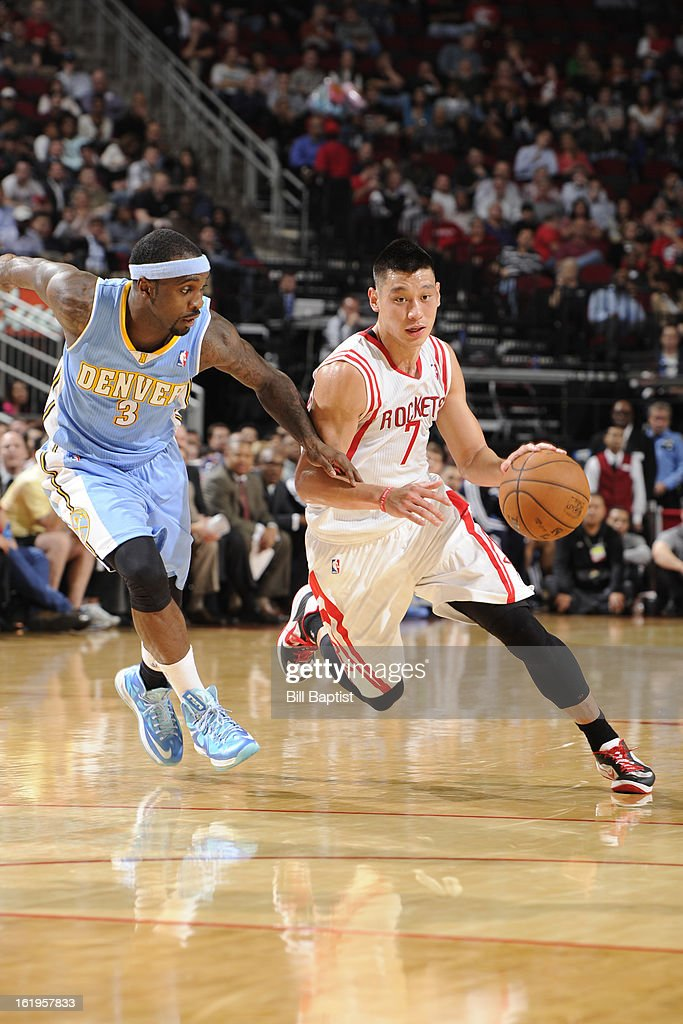 <a gi-track='captionPersonalityLinkClicked' href=/galleries/search?phrase=Jeremy+Lin&family=editorial&specificpeople=6669516 ng-click='$event.stopPropagation()'>Jeremy Lin</a> #7 of the Houston Rockets drives to the basket against the Denver Nuggets on January 23, 2013 at the Toyota Center in Houston, Texas.