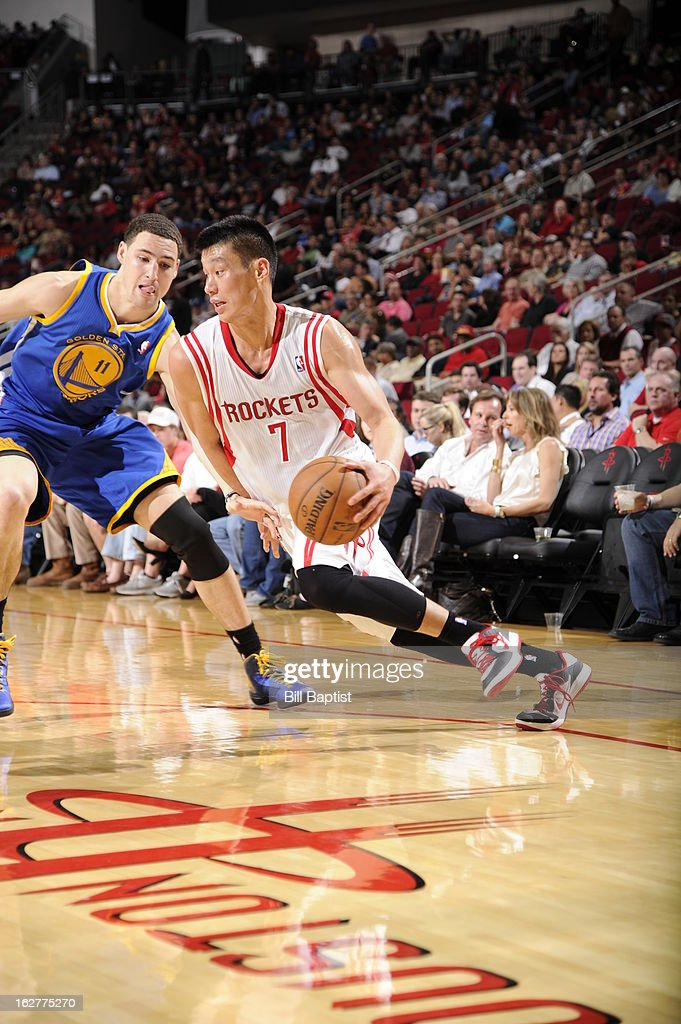 Jeremy Lin #7 of the Houston Rockets drives to the basket against the Golden State Warriors on February 5, 2013 at the Toyota Center in Houston, Texas.