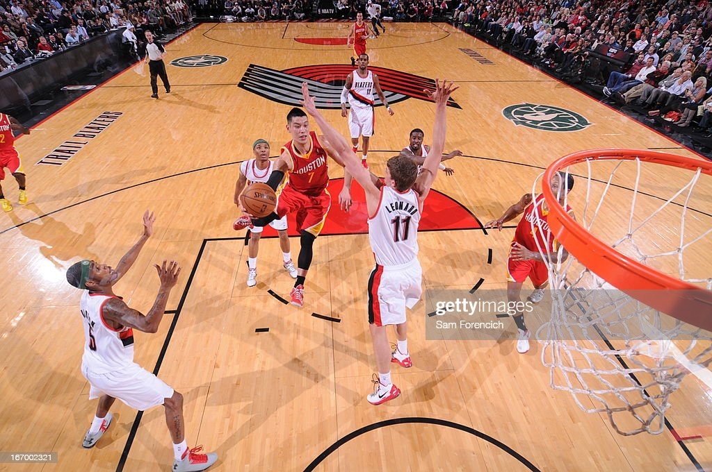 <a gi-track='captionPersonalityLinkClicked' href=/galleries/search?phrase=Jeremy+Lin&family=editorial&specificpeople=6669516 ng-click='$event.stopPropagation()'>Jeremy Lin</a> #7 of the Houston Rockets drives to the basket and passes the ball against the Portland Trail Blazers on April 5, 2013 at the Rose Garden Arena in Portland, Oregon.