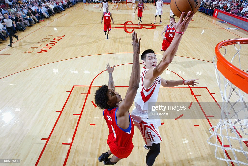 <a gi-track='captionPersonalityLinkClicked' href=/galleries/search?phrase=Jeremy+Lin&family=editorial&specificpeople=6669516 ng-click='$event.stopPropagation()'>Jeremy Lin</a> #7 of the Houston Rockets drives to the basket around Nick Young #1 of the Philadelphia 76ers on December 19, 2012 at the Toyota Center in Houston, Texas.