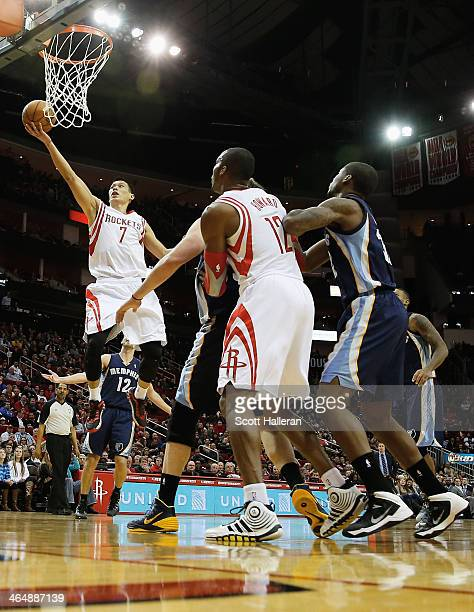 Jeremy Lin of the Houston Rockets drives with the ball against the Memphis Grizzlies during the game at the Toyota Center on January 24 2014 in...