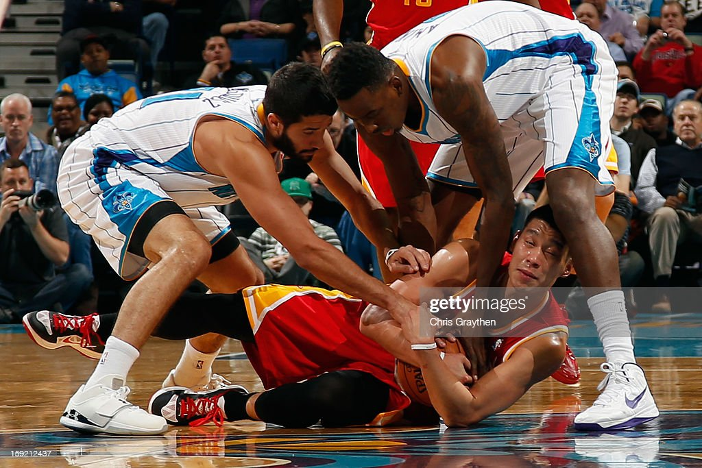 Jeremy Lin #7 of the Houston Rockets fights for a loose ball with Al-Farouq Aminu #0 and Greivis Vasquez #21 of the New Orleans Hornets at New Orleans Arena on January 9, 2013 in New Orleans, Louisiana.