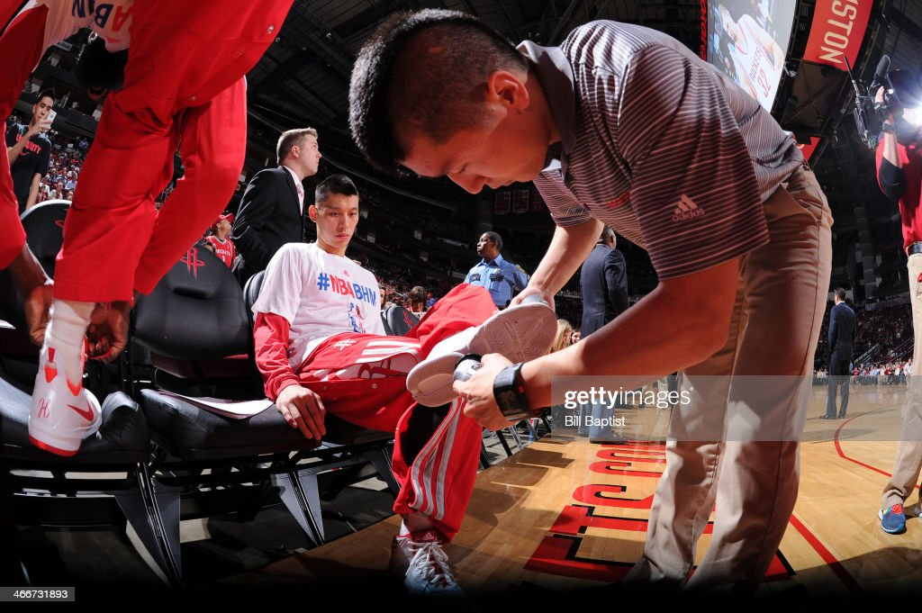 Jeremy Lin #7 of the Houston Rockets gets Court Grip applied to his sneaker prior to the game against the Cleveland Cavaliers on February 1, 2014 at the Toyota Center in Houston, Texas.