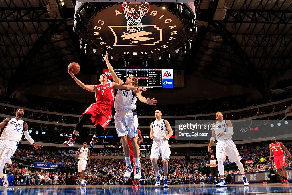 Jeremy Lin #7 of the Houston Rockets goes in for the layup against Dirk Nowitzki #41 of the Dallas Mavericks on January 16, 2013 at the American Airlines Center in Dallas, Texas.