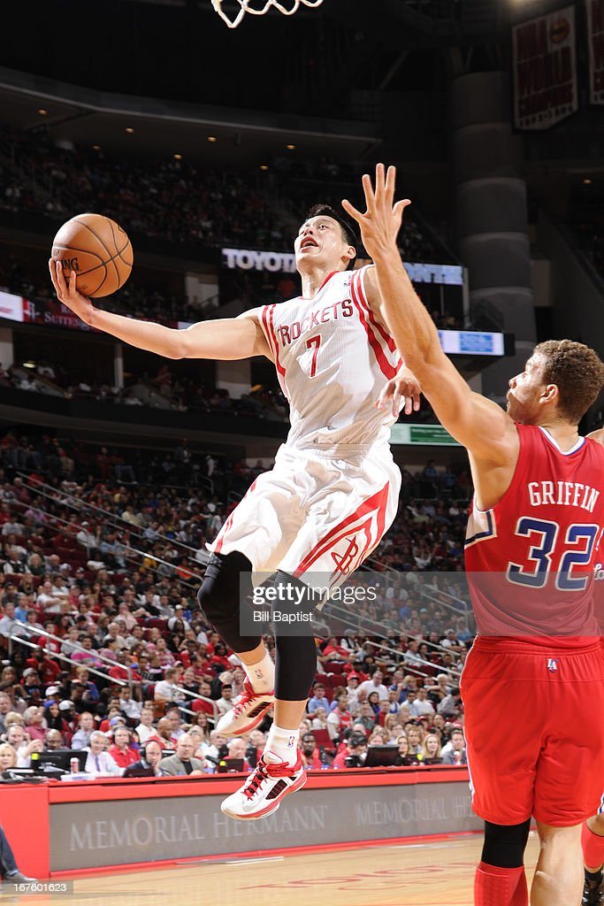 <a gi-track='captionPersonalityLinkClicked' href=/galleries/search?phrase=Jeremy+Lin&family=editorial&specificpeople=6669516 ng-click='$event.stopPropagation()'>Jeremy Lin</a> #7 of the Houston Rockets goes to the basket against <a gi-track='captionPersonalityLinkClicked' href=/galleries/search?phrase=Blake+Griffin+-+Basketball+Player&family=editorial&specificpeople=4216010 ng-click='$event.stopPropagation()'>Blake Griffin</a> #32 of the Los Angeles Clippers on March 30, 2013 at the Toyota Center in Houston, Texas.