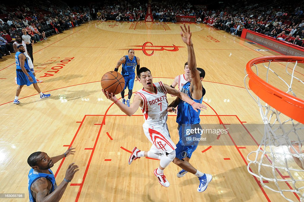 <a gi-track='captionPersonalityLinkClicked' href=/galleries/search?phrase=Jeremy+Lin&family=editorial&specificpeople=6669516 ng-click='$event.stopPropagation()'>Jeremy Lin</a> #7 of the Houston Rockets goes to the basket against Brandon Wright #34 of the Dallas Mavericks on March 3, 2013 at the Toyota Center in Houston, Texas.