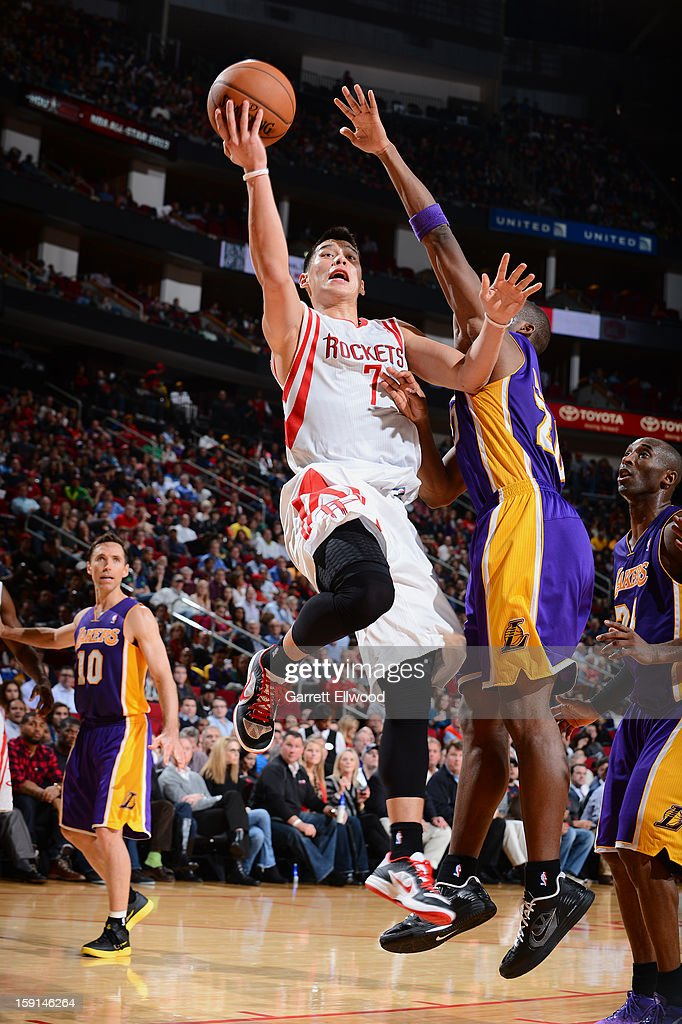 Jeremy Lin #7 of the Houston Rockets goes to the basket against Jodie Meeks #20 of the Los Angeles Lakers on January 8, 2013 at the Toyota Center in Houston, Texas.