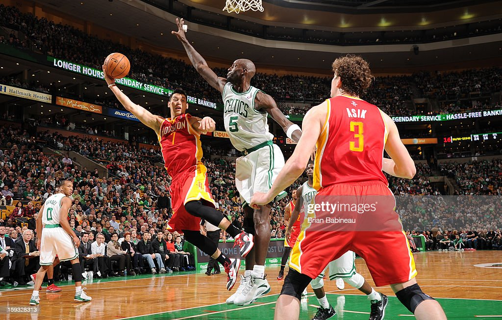 Jeremy Lin #7 of the Houston Rockets goes to the basket against Kevin Garnett #5 of the Boston Celtics on January 11, 2013 at the TD Garden in Boston, Massachusetts.
