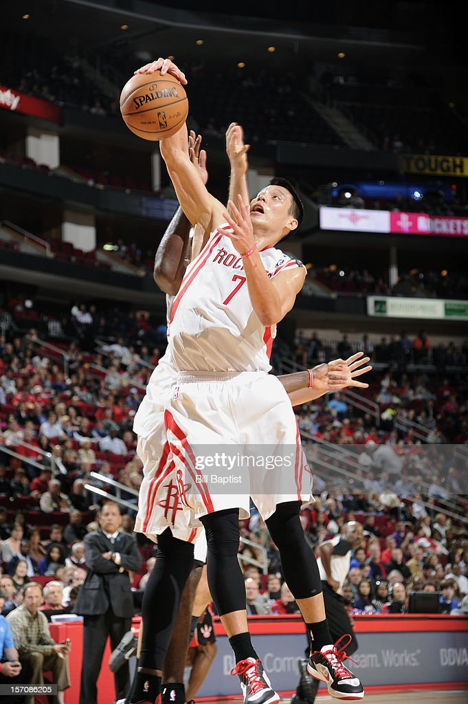 <a gi-track='captionPersonalityLinkClicked' href=/galleries/search?phrase=Jeremy+Lin&family=editorial&specificpeople=6669516 ng-click='$event.stopPropagation()'>Jeremy Lin</a> #7 of the Houston Rockets grabs the rebound against the Toronto Raptors on November 27, 2012 at the Toyota Center in Houston, Texas.