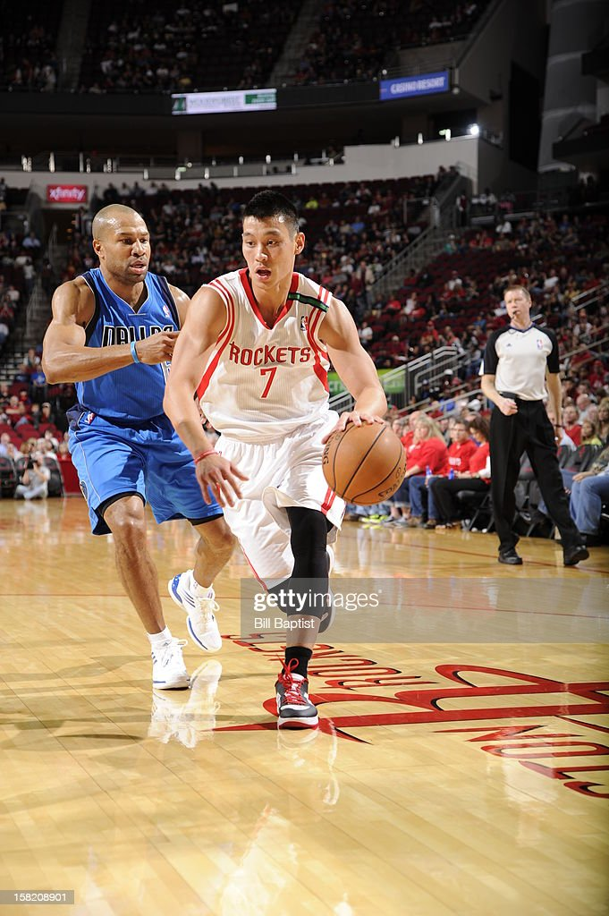 <a gi-track='captionPersonalityLinkClicked' href=/galleries/search?phrase=Jeremy+Lin&family=editorial&specificpeople=6669516 ng-click='$event.stopPropagation()'>Jeremy Lin</a> #7 of the Houston Rockets handles the ball against <a gi-track='captionPersonalityLinkClicked' href=/galleries/search?phrase=Derek+Fisher&family=editorial&specificpeople=201724 ng-click='$event.stopPropagation()'>Derek Fisher</a> #6 of the Dallas Mavericks on December 8, 2012 at the Toyota Center in Houston, Texas.