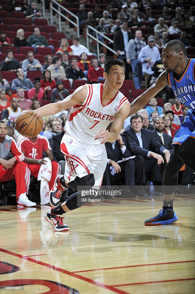 Jeremy Lin #7 of the Houston Rockets handles the ball against Kevin Durant #35 of the Oklahoma City Thunder on December 29, 2012 at the Toyota Center in Houston, Texas.