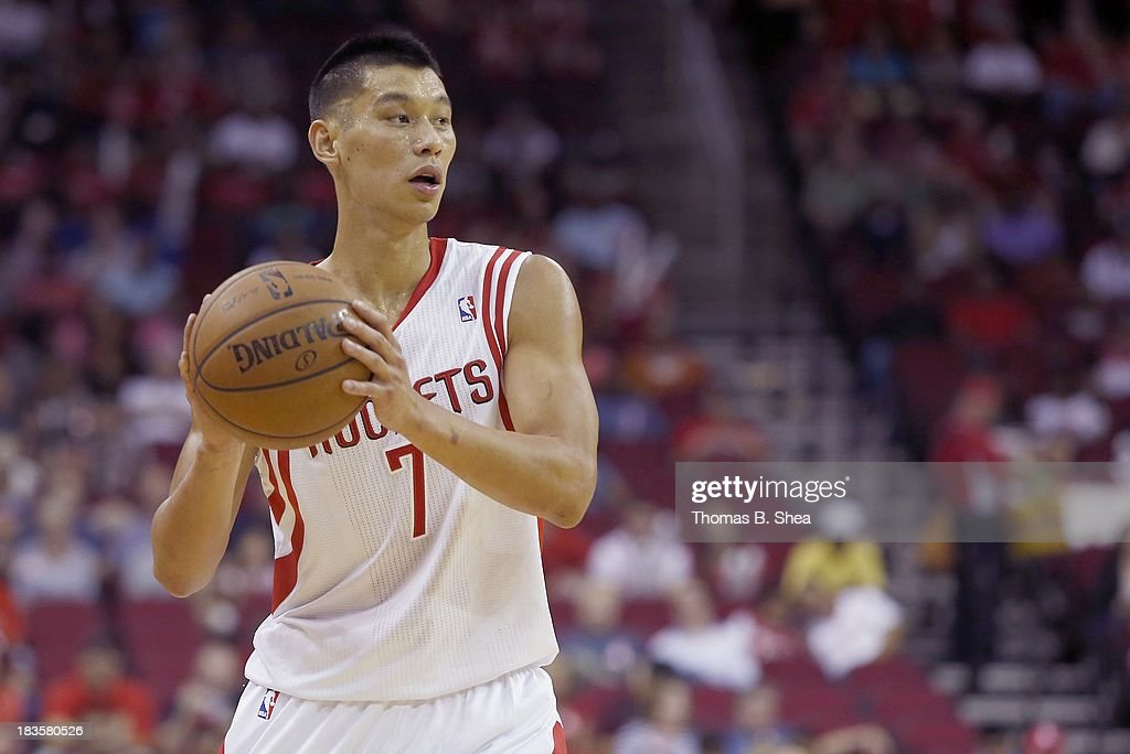 Jeremy Lin #7 of the Houston Rockets handles the ball during a preseason game against the New Orleans Pelicans on October 5, 2013 at Toyota Center in Houston, Texas. The Pelicans won 116 to 115.