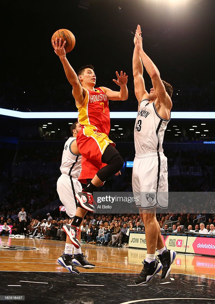 Jeremy Lin #7 of the Houston Rockets in action against Kris Humphries #43 of the Brooklyn Nets during their game at the Barclays Center on February 22, 2013 in the Brooklyn borough of New York City.