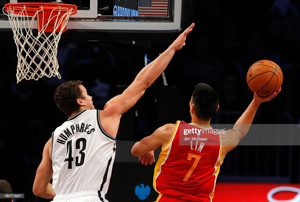 Jeremy Lin #7 of the Houston Rockets in action against Kris Humphries #43 of the Brooklyn Nets at Barclays Center on February 22, 2013 in the Brooklyn borough of New York City.The Rockets defeated the Nets 106-96.