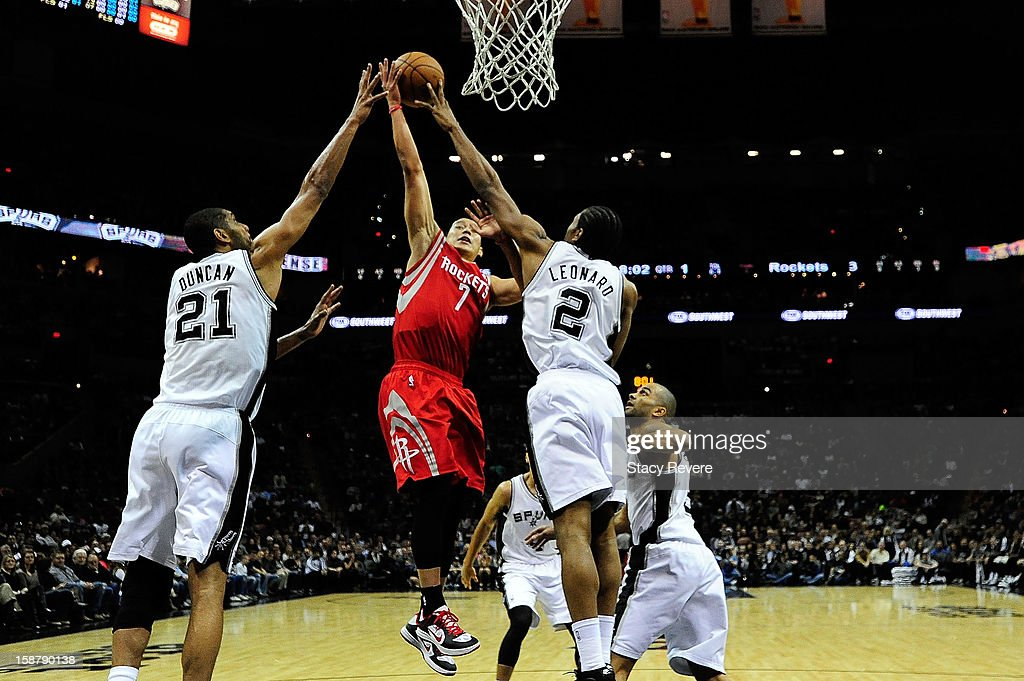 Jeremy Lin #7 of the Houston Rockets is defended by Kawhi Leonard #2 and Tim Duncan #21 of the San Antonio Spurs during a game at AT&T Center on December 28, 2012 in San Antonio, Texas. San Antonio won the game 122-116.