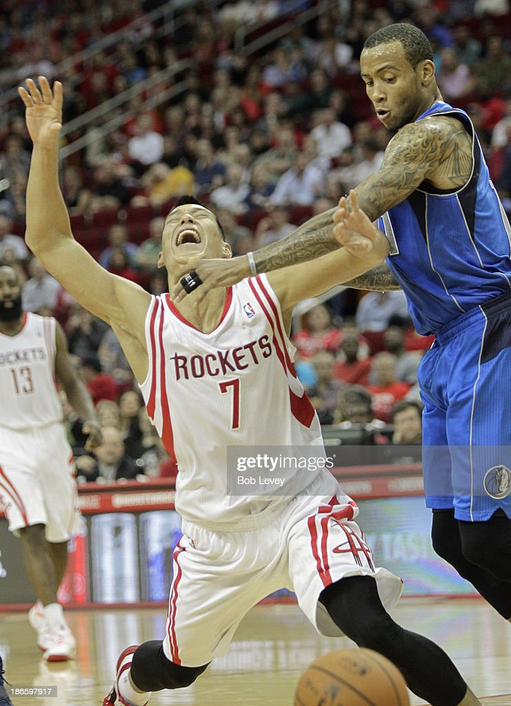 <a gi-track='captionPersonalityLinkClicked' href=/galleries/search?phrase=Jeremy+Lin&family=editorial&specificpeople=6669516 ng-click='$event.stopPropagation()'>Jeremy Lin</a> #7 of the Houston Rockets is fouled by <a gi-track='captionPersonalityLinkClicked' href=/galleries/search?phrase=Monta+Ellis&family=editorial&specificpeople=567403 ng-click='$event.stopPropagation()'>Monta Ellis</a> #11 of the Dallas Mavericks as he drives to the basket in the fourth quarter at Toyota Center on November 1, 2013 in Houston, Texas.