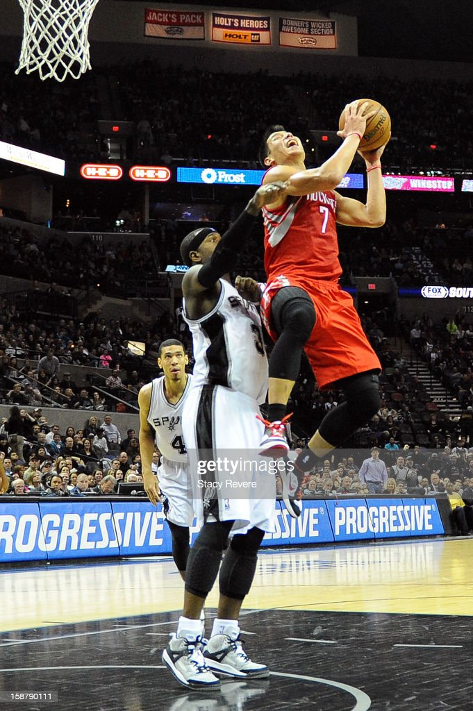 Jeremy Lin #7 of the Houston Rockets is fouled by Stephen Jackson #3 of the San Antonio Spurs during a game at AT&T Center on December 28, 2012 in San Antonio, Texas. San Antonio won the game 122-116.