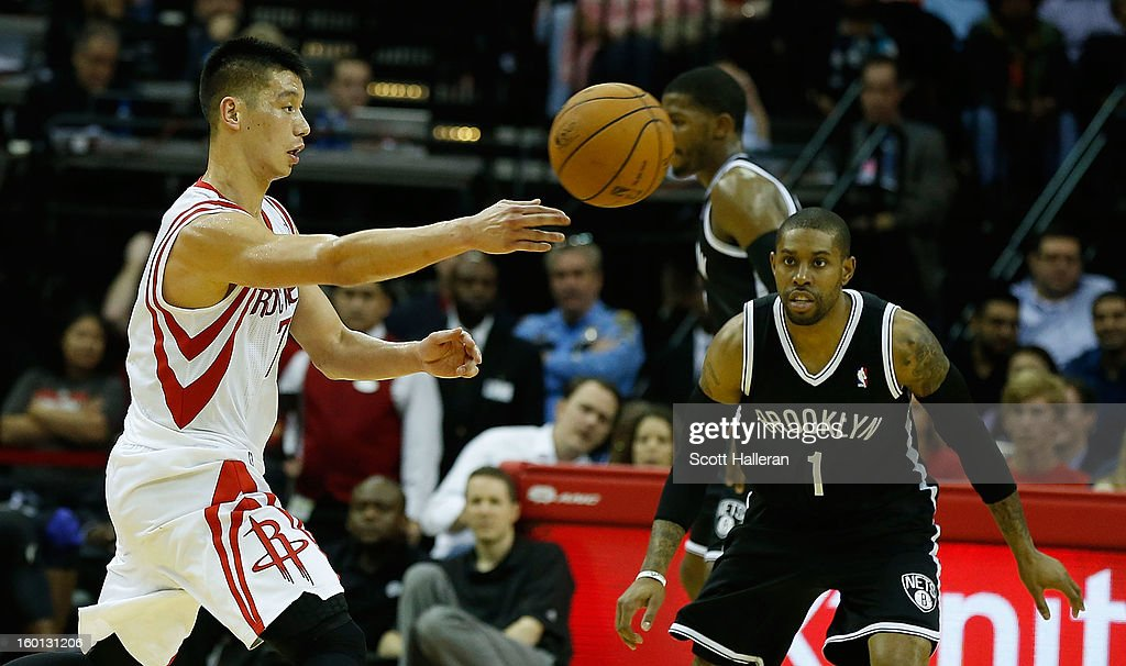 Jeremy Lin #7 of the Houston Rockets looks to pass against C.J. Watson #1 of the Brooklyn Nets at Toyota Center on January 26, 2013 in Houston, Texas.