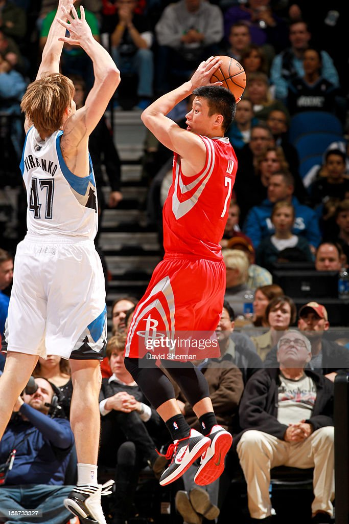 Jeremy Lin #7 of the Houston Rockets looks to pass the ball against Andrei Kirilenko #47 of the Minnesota Timberwolves on December 26, 2012 at Target Center in Minneapolis, Minnesota.