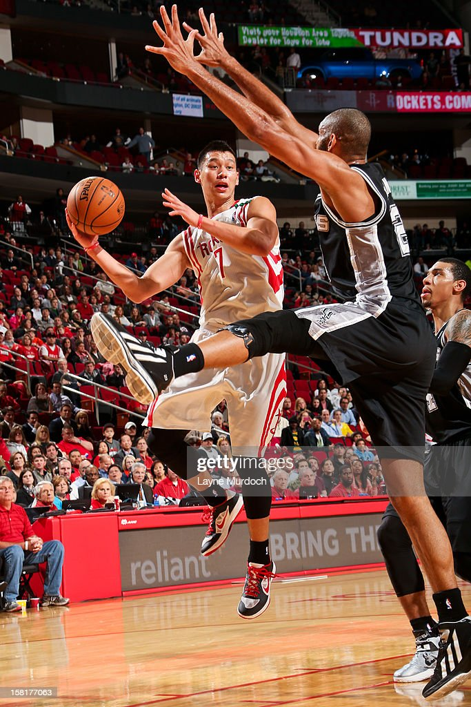 <a gi-track='captionPersonalityLinkClicked' href=/galleries/search?phrase=Jeremy+Lin&family=editorial&specificpeople=6669516 ng-click='$event.stopPropagation()'>Jeremy Lin</a> #7 of the Houston Rockets looks to pass the ball against <a gi-track='captionPersonalityLinkClicked' href=/galleries/search?phrase=Tim+Duncan&family=editorial&specificpeople=201467 ng-click='$event.stopPropagation()'>Tim Duncan</a> #21 of the San Antonio Spurs on December 10, 2012 at the Toyota Center in Houston, Texas.
