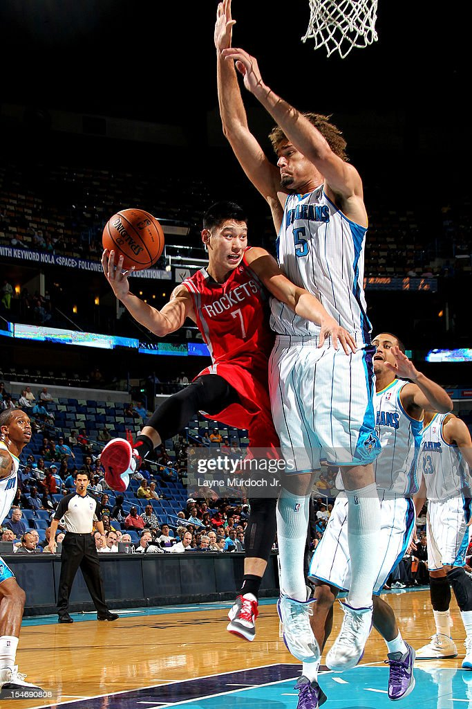 <a gi-track='captionPersonalityLinkClicked' href=/galleries/search?phrase=Jeremy+Lin&family=editorial&specificpeople=6669516 ng-click='$event.stopPropagation()'>Jeremy Lin</a> #7 of the Houston Rockets passes the ball against <a gi-track='captionPersonalityLinkClicked' href=/galleries/search?phrase=Robin+Lopez&family=editorial&specificpeople=2351509 ng-click='$event.stopPropagation()'>Robin Lopez</a> #15 of the New Orleans Hornets on October 24, 2012 at the New Orleans Arena in New Orleans, Louisiana.