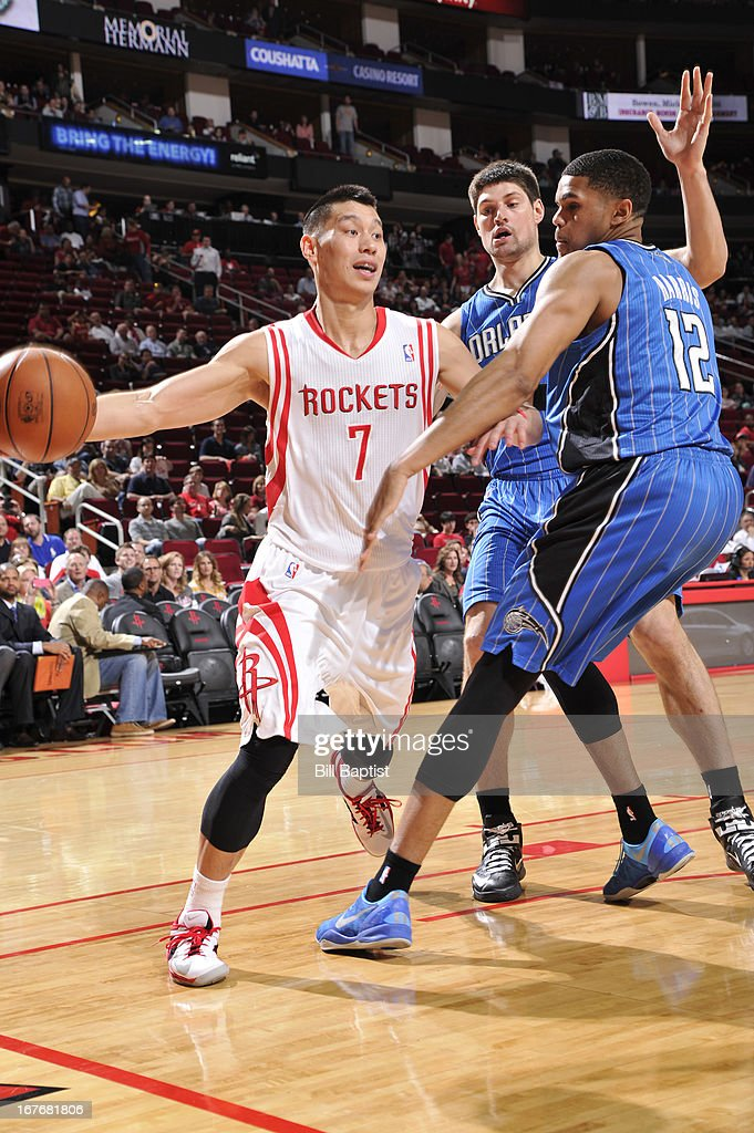 <a gi-track='captionPersonalityLinkClicked' href=/galleries/search?phrase=Jeremy+Lin&family=editorial&specificpeople=6669516 ng-click='$event.stopPropagation()'>Jeremy Lin</a> #7 of the Houston Rockets passes the ball against <a gi-track='captionPersonalityLinkClicked' href=/galleries/search?phrase=Tobias+Harris&family=editorial&specificpeople=6902922 ng-click='$event.stopPropagation()'>Tobias Harris</a> #12 and Nikola Vucevic #9 of the Orlando Magic on April 1, 2013 at the Toyota Center in Houston, Texas.