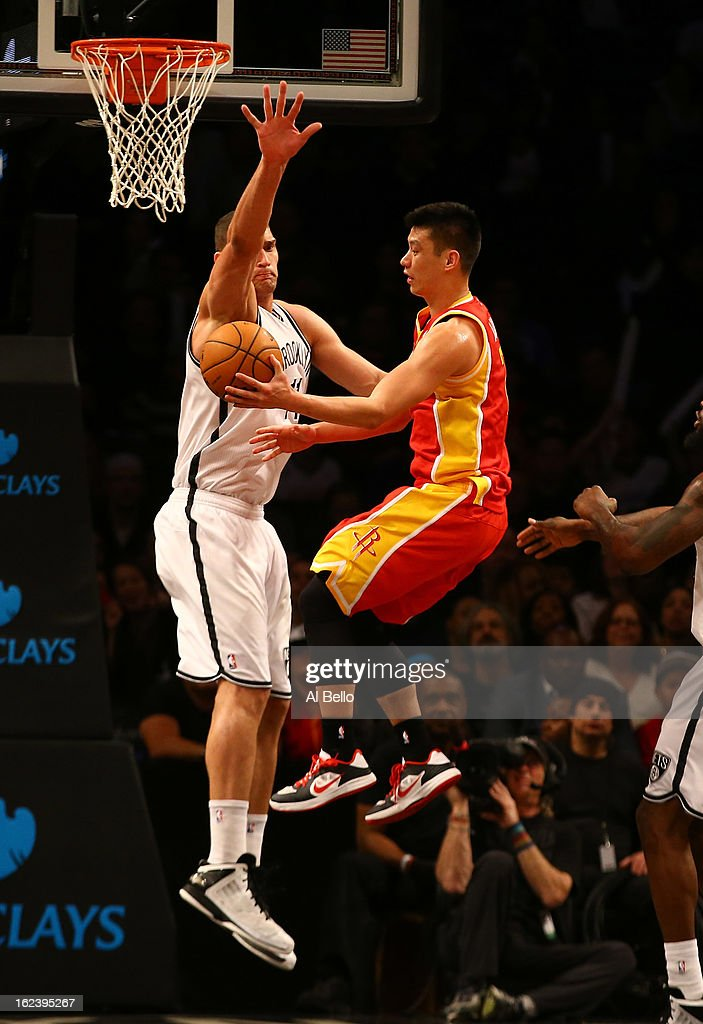 <a gi-track='captionPersonalityLinkClicked' href=/galleries/search?phrase=Jeremy+Lin&family=editorial&specificpeople=6669516 ng-click='$event.stopPropagation()'>Jeremy Lin</a> #7 of the Houston Rockets passes the ball as <a gi-track='captionPersonalityLinkClicked' href=/galleries/search?phrase=Brook+Lopez&family=editorial&specificpeople=3847328 ng-click='$event.stopPropagation()'>Brook Lopez</a> #11 of the Brooklyn Nets defends during their game at the Barclays Center on February 22, 2013 in the Brooklyn borough of New York City.
