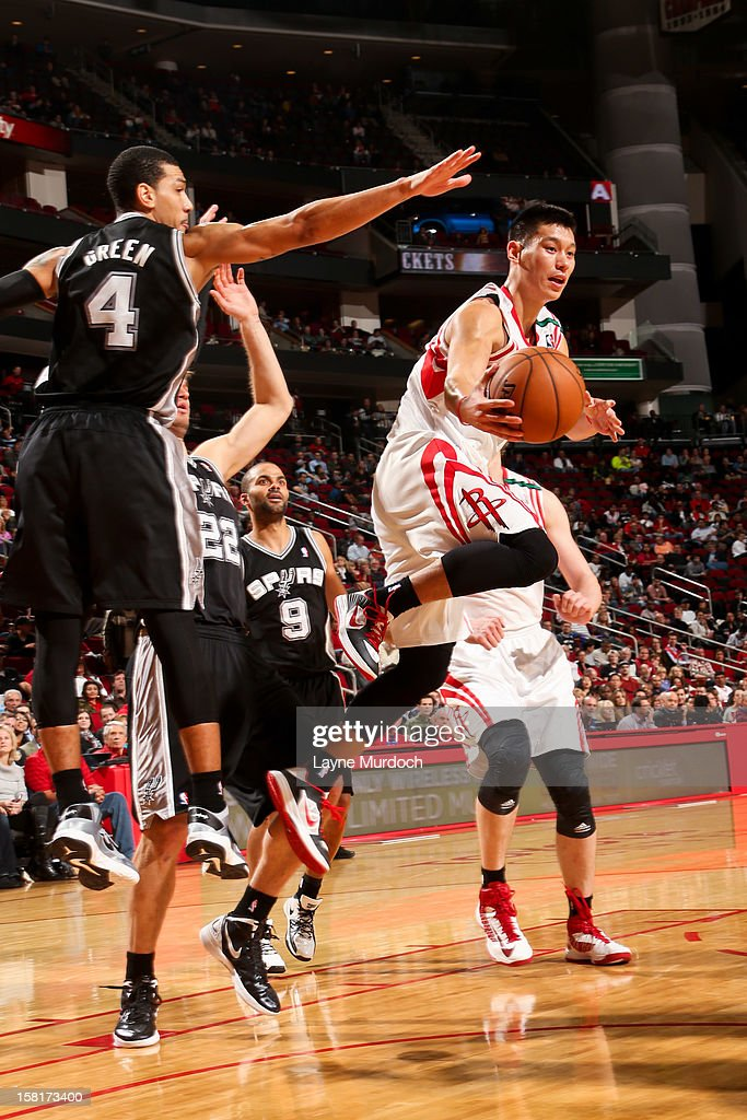 Jeremy Lin #7 of the Houston Rockets passes the ball in the lane against Danny Green #4 of the San Antonio Spurs on December 10, 2012 at the Toyota Center in Houston, Texas.