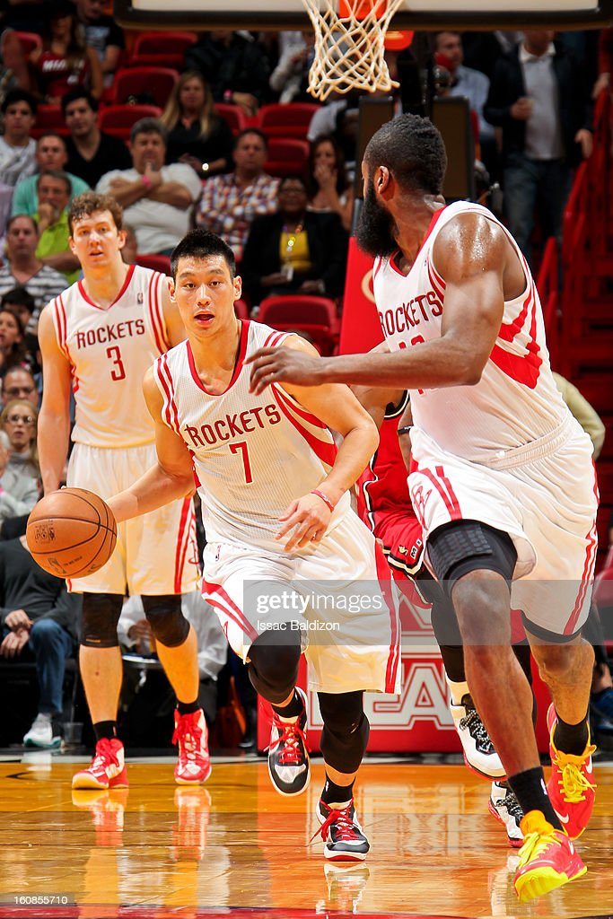 Jeremy Lin #7 of the Houston Rockets passes the ball to teammate James Harden #13 against the Miami Heat on February 6, 2013 at American Airlines Arena in Miami, Florida.