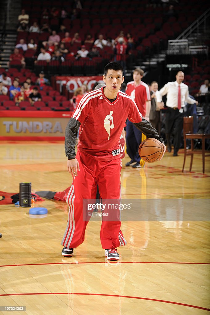 Jeremy Lin #7 of the Houston Rockets practices before the game against the Utah Jazz supporting a World AIDS Day warm up on December 1, 2012 at the Toyota Center in Houston, Texas.