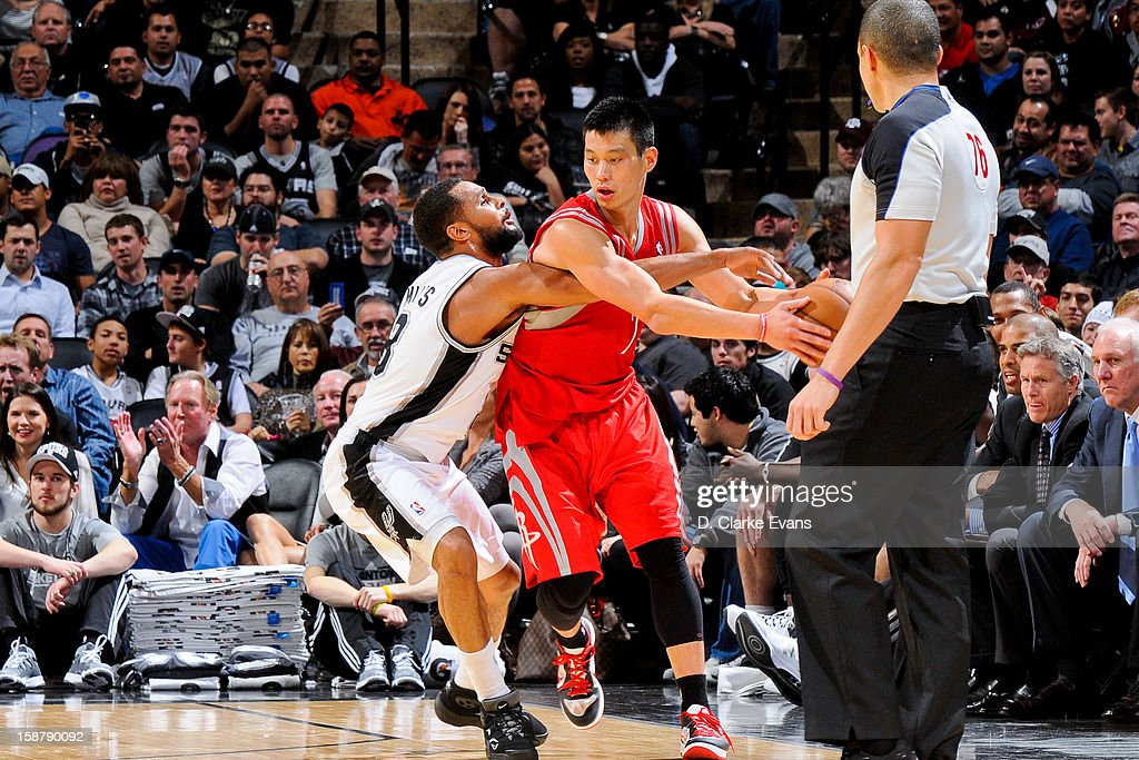 Jeremy Lin #7 of the Houston Rockets protects the ball against Patty Mills #8 of the San Antonio Spurs on December 28, 2012 at the AT&T Center in San Antonio, Texas.