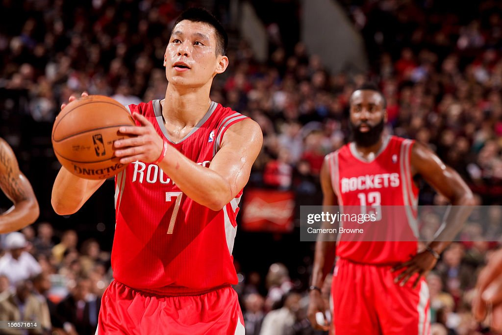 <a gi-track='captionPersonalityLinkClicked' href=/galleries/search?phrase=Jeremy+Lin&family=editorial&specificpeople=6669516 ng-click='$event.stopPropagation()'>Jeremy Lin</a> #7 of the Houston Rockets shoots a free-throw as teammate <a gi-track='captionPersonalityLinkClicked' href=/galleries/search?phrase=James+Harden&family=editorial&specificpeople=4215938 ng-click='$event.stopPropagation()'>James Harden</a> #13 looks on against the Portland Trail Blazers on November 16, 2012 at the Rose Garden Arena in Portland, Oregon.