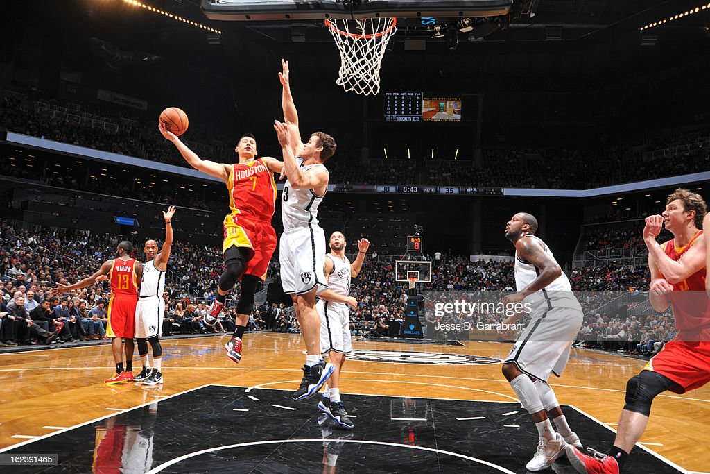 Jeremy Lin #7 of the Houston Rockets shoots a layup against Kris Humphries #43 of the Brooklyn Nets at the Barclays Center on February 22, 2013 in Brooklyn, New York.