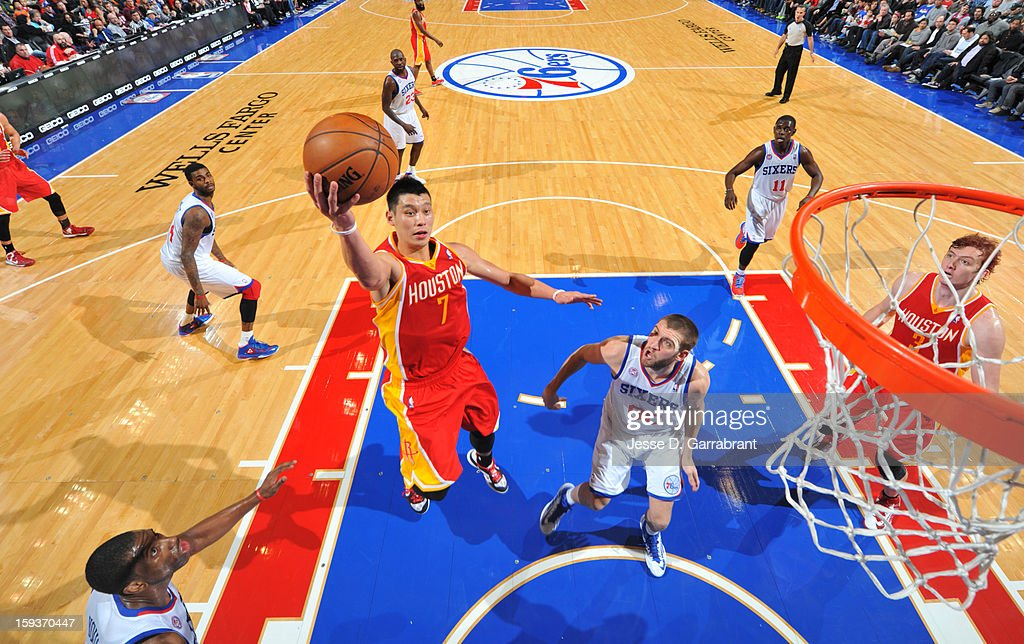Jeremy Lin #7 of the Houston Rockets shoots a layup against Spencer Hawes #00 of the Philadelphia 76ers during the game at the Wells Fargo Center on January 12, 2013 in Philadelphia, Pennsylvania.