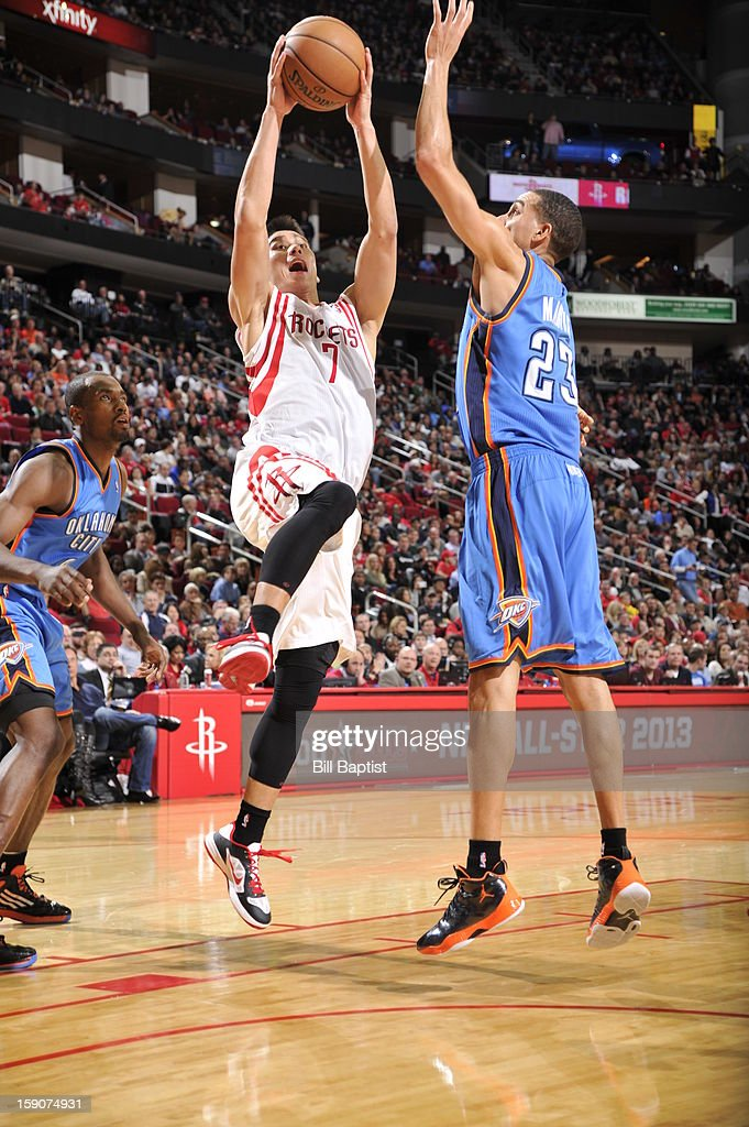 Jeremy Lin #7 of the Houston Rockets shoots against Kevin Martin #23 of the Oklahoma City Thunder on December 29, 2012 at the Toyota Center in Houston, Texas.