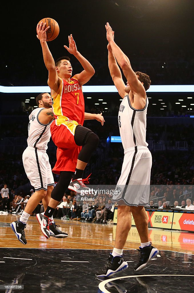 Jeremy Lin #7 of the Houston Rockets shoots against Kris Humphries #43 of the Brooklyn Nets during their game at the Barclays Center on February 22, 2013 in the Brooklyn borough of New York City.