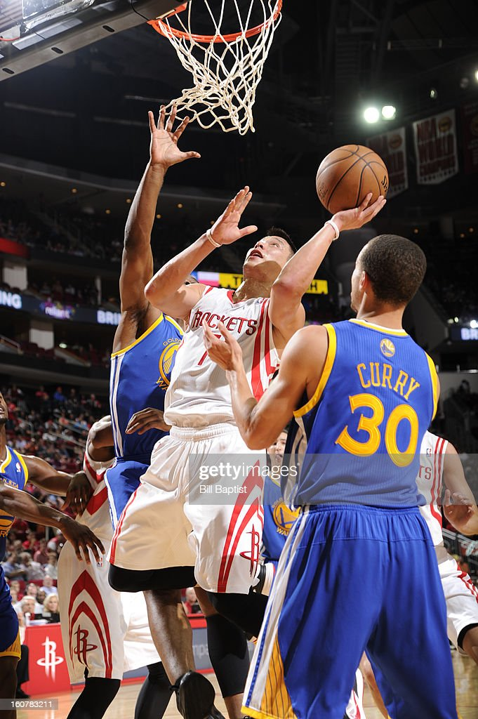 Jeremy Lin #7 of the Houston Rockets shoots against Stephen Curry #30 of the Golden State Warriors on February 5, 2013 at the Toyota Center in Houston, Texas.