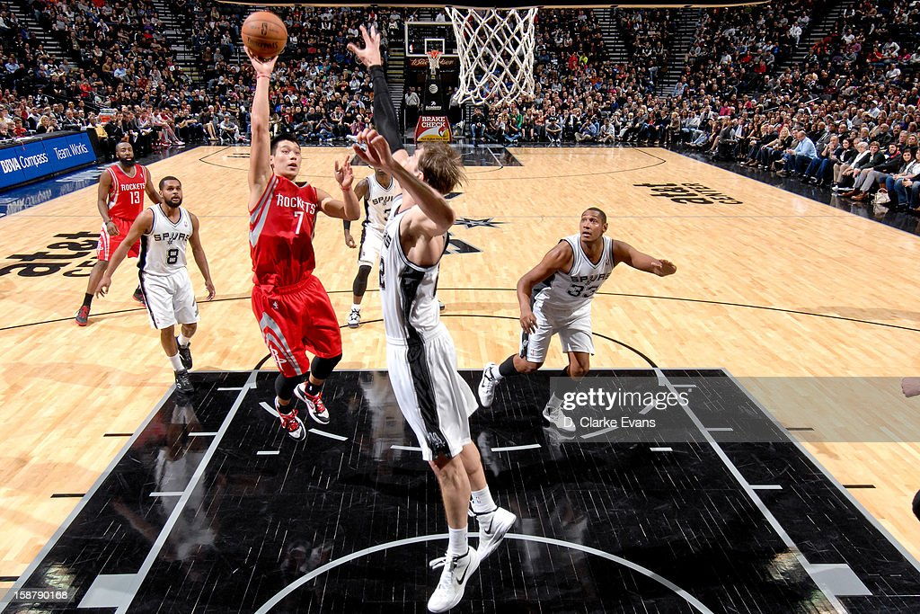 Jeremy Lin #7 of the Houston Rockets shoots in the lane against Tiago Splitter #22 of the San Antonio Spurs on December 28, 2012 at the AT&T Center in San Antonio, Texas.