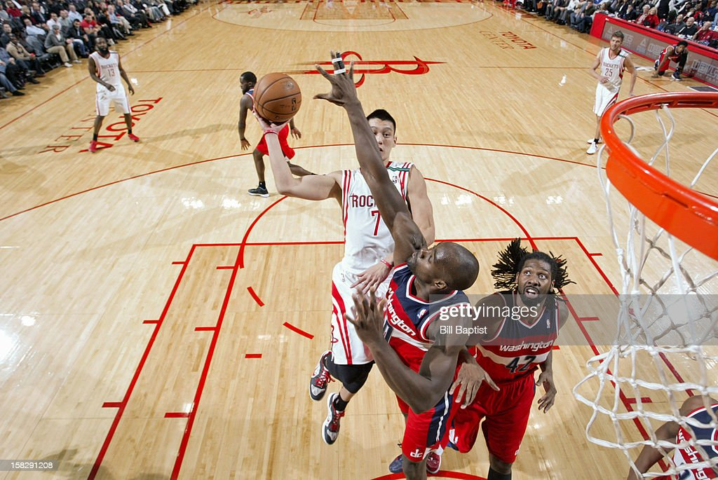 <a gi-track='captionPersonalityLinkClicked' href=/galleries/search?phrase=Jeremy+Lin&family=editorial&specificpeople=6669516 ng-click='$event.stopPropagation()'>Jeremy Lin</a> #7 of the Houston Rockets shoots the ball against <a gi-track='captionPersonalityLinkClicked' href=/galleries/search?phrase=Emeka+Okafor&family=editorial&specificpeople=201739 ng-click='$event.stopPropagation()'>Emeka Okafor</a> #50 of the Washington Wizards on December 12, 2012 at the Toyota Center in Houston, Texas.
