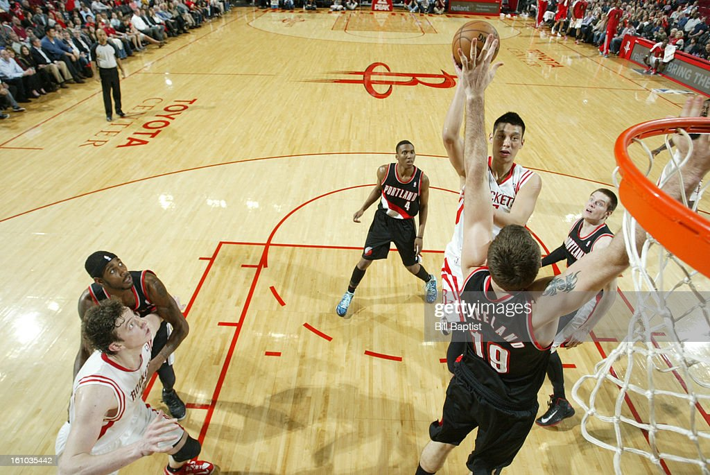 Jeremy Lin #7 of the Houston Rockets shoots the ball over Joel Freeland #19 of the Portland Trail Blazers on February 8, 2013 at the Toyota Center in Houston, Texas.