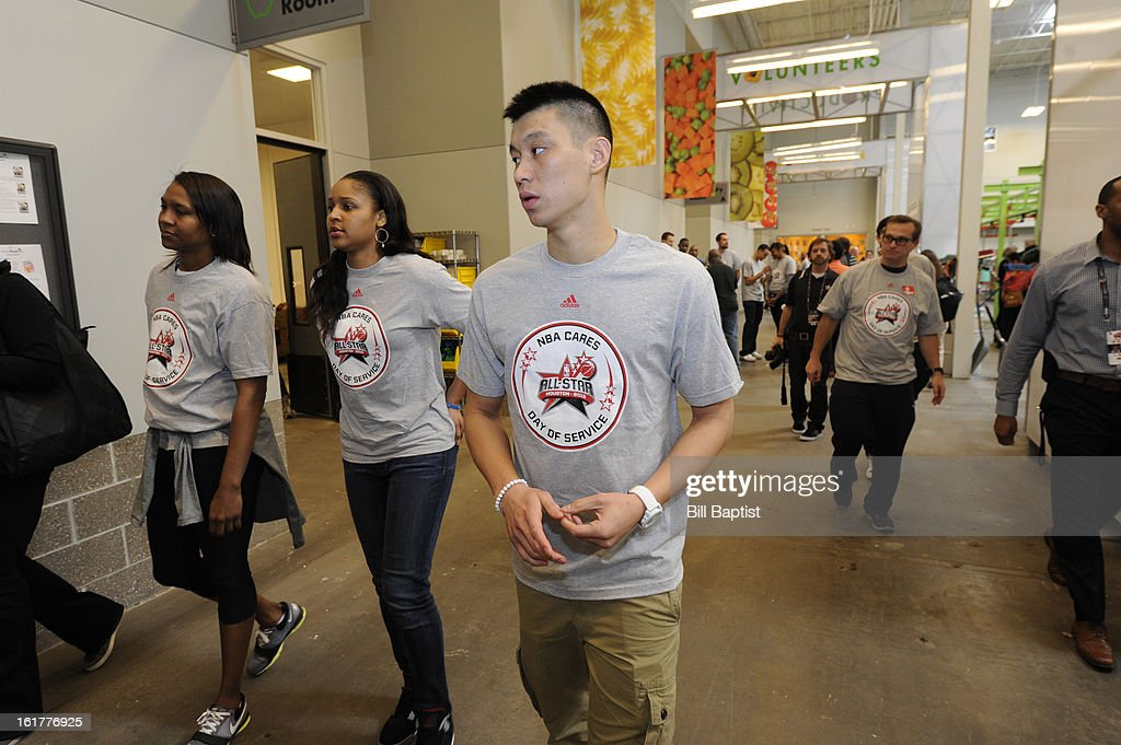 Jeremy Lin #7 of the Houston Rockets walks down the hallway after the event at the 2013 NBA Cares Day of Service at the Food Bank sorting on February 15, 2013 in Houston, Texas.