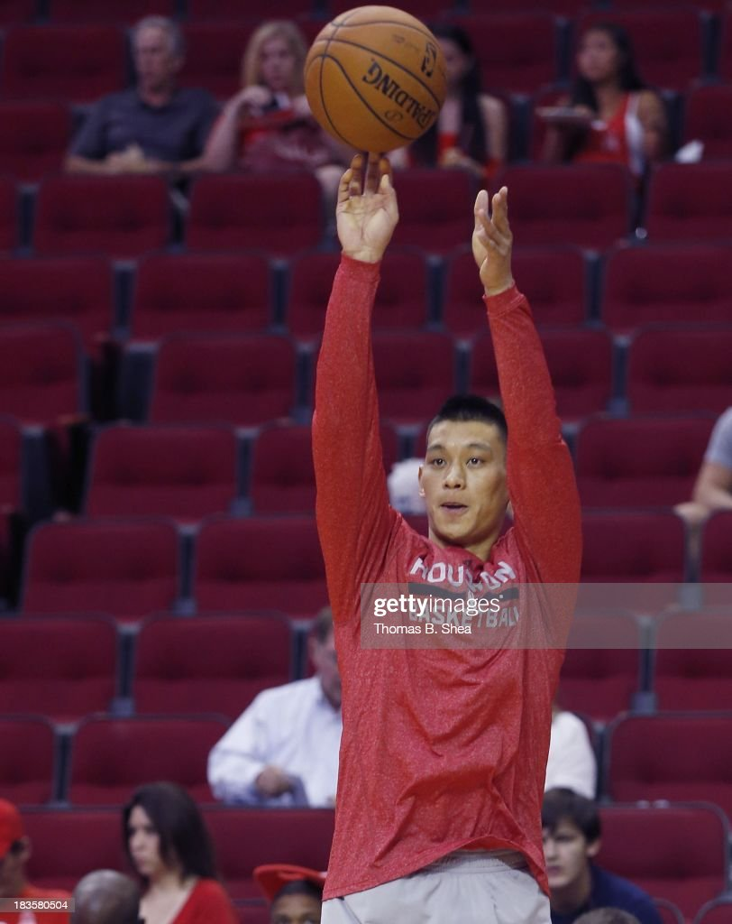Jeremy Lin #7 of the Houston Rockets warms up before playing against the New Orleans Pelicans in a preseason NBA game on October 5, 2013 at Toyota Center in Houston, Texas. The Pelicans won 116 to 115.