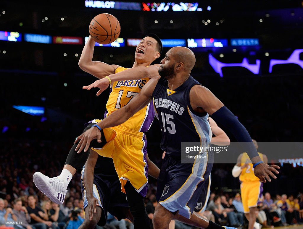 Jeremy Lin of the Los Angeles Lakers is fouled driving to the basket by Vince Carter of the Memphis Grizzlies during the first half at Staples Center...