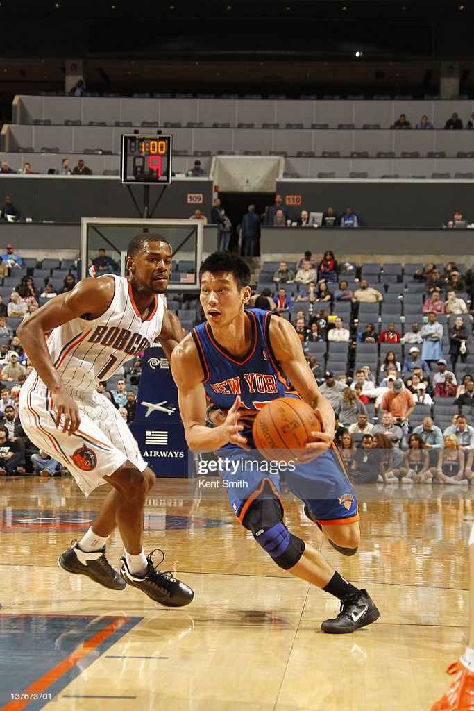 Jeremy Lin #17 of the New York Knicks drives against Cory Higgins #11 of the Charlotte Bobcats during the game at the Time Warner Cable Arena on January 24, 2012 in Charlotte, North Carolina.