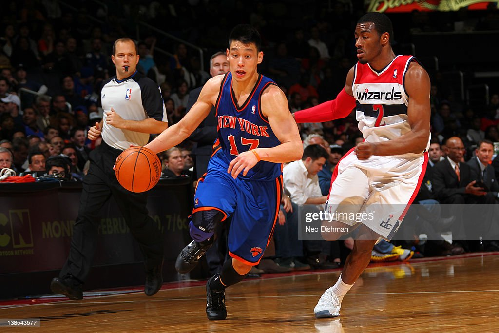 <a gi-track='captionPersonalityLinkClicked' href=/galleries/search?phrase=Jeremy+Lin&family=editorial&specificpeople=6669516 ng-click='$event.stopPropagation()'>Jeremy Lin</a> #17 of the New York Knicks drives against <a gi-track='captionPersonalityLinkClicked' href=/galleries/search?phrase=John+Wall&family=editorial&specificpeople=2265812 ng-click='$event.stopPropagation()'>John Wall</a> #2 of the Washington Wizards during the game at the Verizon Center on February 8, 2012 in Washington, DC.