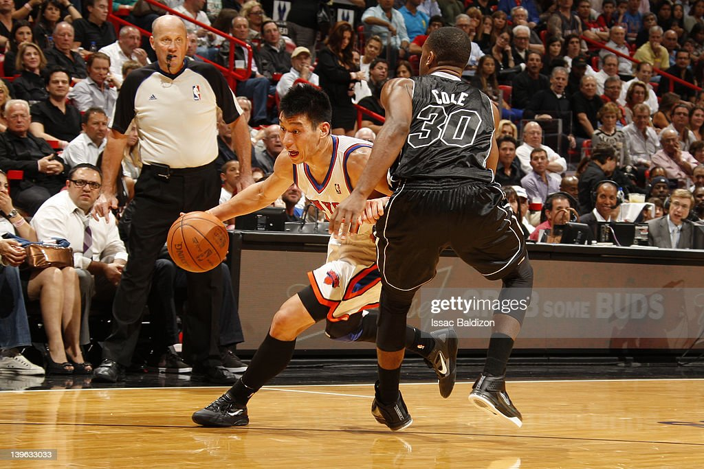Jeremy Lin of the New York Knicks drives to the basket against Norris Cole of the Miami Heat during the game on February 23 2012 at American Airlines...