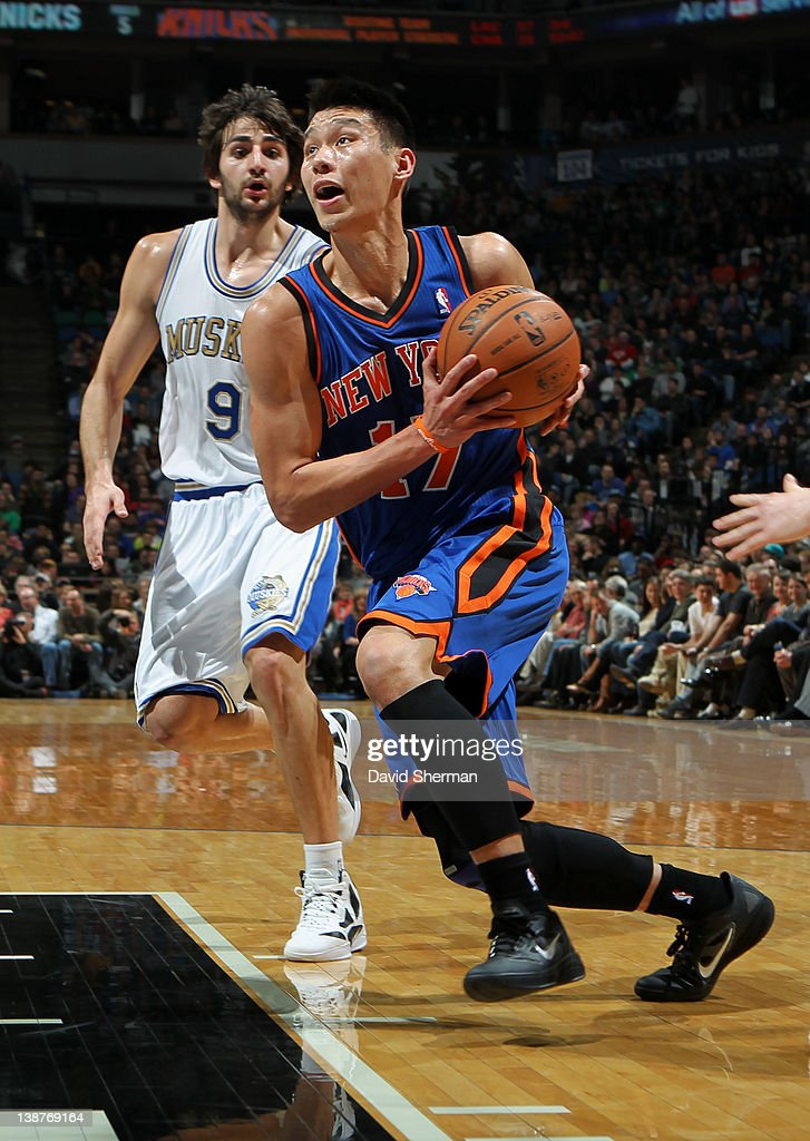 Jeremy Lin of the New York Knicks drives to the basket against Ricky Rubio of the Minnesota Timberwolves during the game on February 11 2012 at...